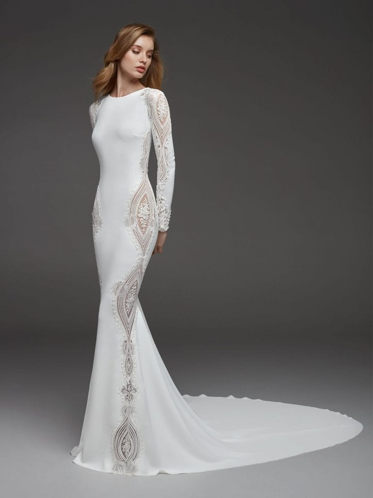 Wedding dress in crepe with mermaid cut, bateau neckline and long sleeves back front